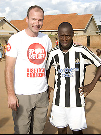 Alan Shearer poses with a Newcastle fan in Uganda