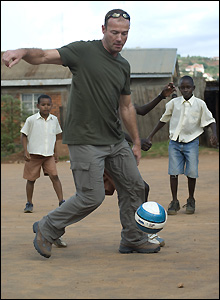 Alan Shearer plays football with children in Kampala