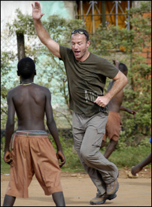 Alan Shearer celebrates scoring against children in Africa