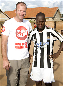 Alan Shearer poses with a Newcastle fan on his Sport Relief trip to Africa.