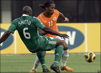 Ivory Coast's Drogba looks for the opening goal