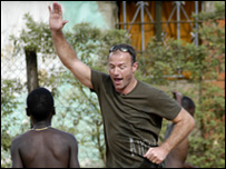 Alan Shearer celebrates scoring a goal in Uganda