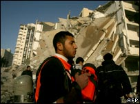 Rescue teams work outside a destroyed building that was used by Hamas as interior ministry following an Israeli air strike on Gaza City on 18 January 2008.