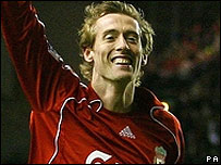Peter Crouch celebrates his late equaliser for Liverpool