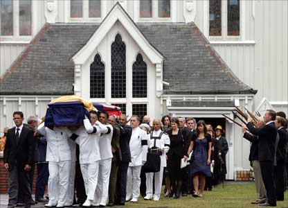 The coffin of Sir Edmund Hillary is carried from St Mary's Cathedral in Auckland.