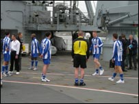 HMS Albion's football team training on deck