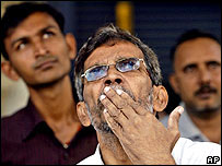 Mumbai stock exchange workers react to share fall