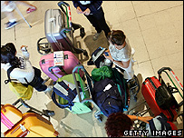 Passengers at an airport departure lounge (Getty Images)