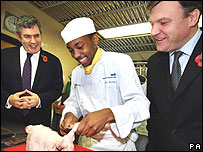 Ed Balls watching a cookery lesson