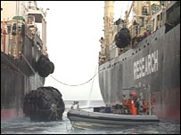 Anti-whaling activists try to prevent whaling vessels coming alongside one another