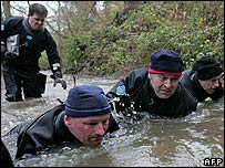 Police divers searching Belstead Brook, near Ipswich in  December 2006