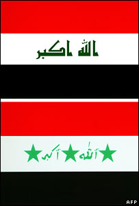 Iraq's new flag at the top and old flag bearing Saddam Hussein's handwriting at the bottom