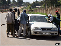 Kikuyu youths stop a car at a checkpoints