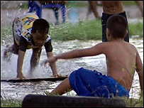 Children playing in the floodwater (Image: BBC)