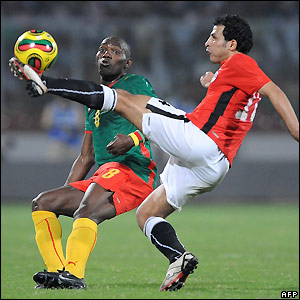 Geremi and Sayed Moawad contest possession