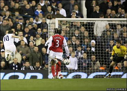 Keane lashes a shot towards goal