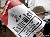 Protester holds poster calling Mr Wilders an extremist 19 January