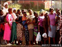A group of women queue for food near the Mathare slum in Nairobi, Kenya