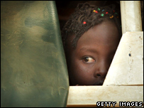 A girl looks out of a truck in Nakuru, Kenya