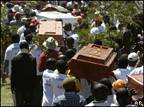 Coffins of people killed in clashes last week are brought to a memorial service in Nairobi, Kenya