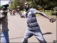 Kenyan opposition supporters throw rocks at the police in Nairobi