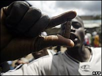 Resident of Mathare slum shows the spent casing of a bullet reportedly fired by Kenyan police