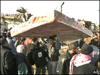 Gaza residents at breached wall into Egypt