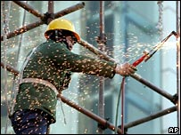 A worker at a construction site in Beijing on 24 January 2007