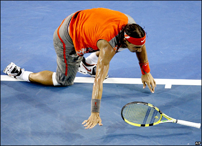 Rafael Nadal slips over as Tsonga turns the screw