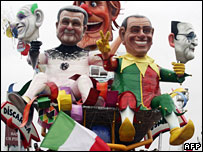 Giant carnival masks represent PM Romano Prodi and former PM Silvio Berlusconi during a carnival parade on 20 Jan 08