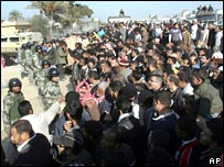 Egyptian guards hold back crowd