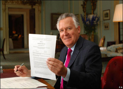Northern Ireland Secretary Peter Hain signs the order paving the way for a new era of power-sharing in Northern Ireland