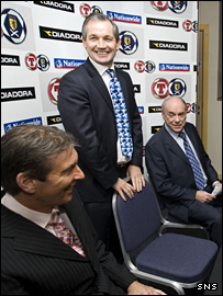 George Burley - standing - with SFA chief executive Gordon Smith (left) and SFA president George Peat