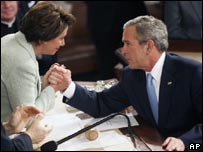 Speaker of the House of Representatives Nancy Pelosi of the Democratic Party (left) shakes hands with President Bush