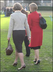 Two ladies make their way to the pitch before kick-off
