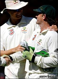 Stuart Clark with Adam Gilchrist