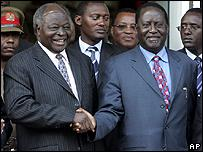Kenyan President Mwai Kibaki (R) shakes hands with opposition leader Raila Odinga in Nairobi