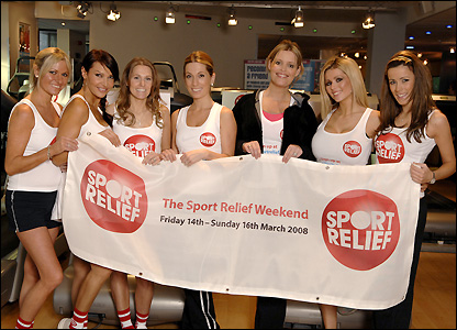 The WAGs show off the Sport Relief banner and urge everyone to get involved