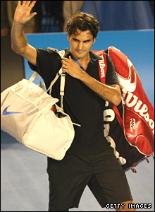 Federer waves to the crowd after being defeated
