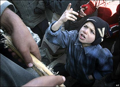 Afghan boy arguing with police