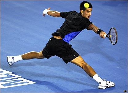 Novak Djokovic stretches for a ball