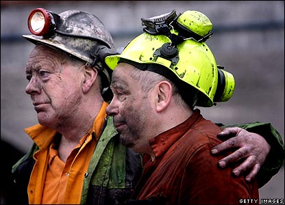 Miners standing side by side