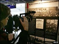 A reporter at the exhibition in Berlin