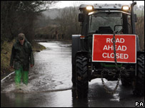 Tractor in flooded road