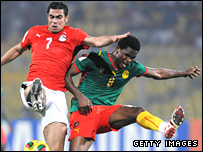 Samuel Eto'o (right) tussles with Abdel Meneim Ibrahim Fathy of Egypt
