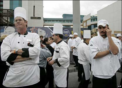 Employees of the Monte Carlo hotel and casino stand outside having been evacuated