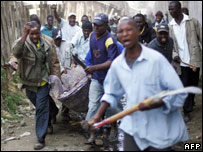 Members of the Luo tribe carry another Luo after he was attacked by a Kikuyu crowd  25.01.08