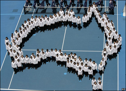A children's choir outline a map of Australia on Rod Laver Arena to mark Australia Day