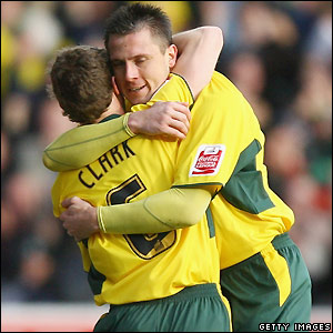 Chris Clark and Krisztian Timar celebrate