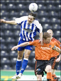 Killie's Danny Invincible wins an aerial battle with Robson